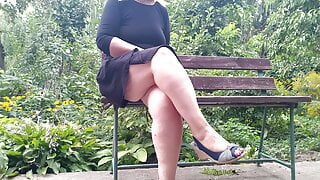 Lustful MILF pissing while sitting on a bench